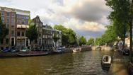 Canals of amsterdam in the summer. Stock Photos