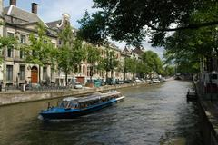 Excursion boat on the canals of amsterdam. Stock Photos
