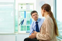 team members discussing current business situation - stock photo