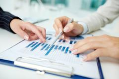 Close-up shot of business graphs indicating corporate progress Stock Photos