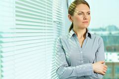 Pretty business lady contemplating about the future of business Stock Photos