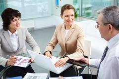 business group working together in office - stock photo