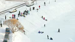 Children riding from the hills in winter season, Saint-Petersburg. Stock Footage