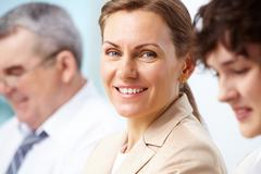 Smiling business woman looking directly at camera Stock Photos