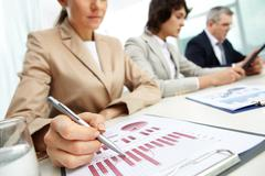 female business lady carrying out the business data analysis - stock photo