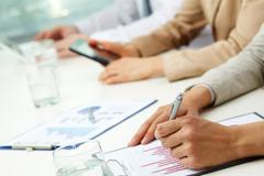 Close-up of clipboards with business graphs and diagrams attached to them Stock Photos