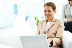 Elegant business woman working on computer Stock Photos