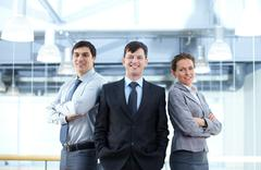 successful businesspeople looking at camera and smiling - stock photo