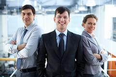 portrait of a confident business team looking at camera and smiling - stock photo