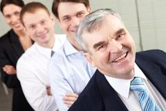 image of a happy senior chief and his team - stock photo