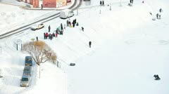 Happy children riding from the hills in winter season, Saint-Petersburg. Stock Footage