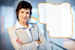 young pretty businesswoman with a speech bubble making a business announcement, - stock photo