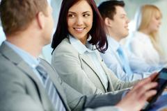 young and positive business people attending training - stock photo