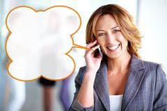 Pretty business woman talking on the phone and looking at camera, useful for ads Stock Photos