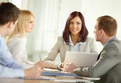strong business team sitting together and holding a discussion - stock photo