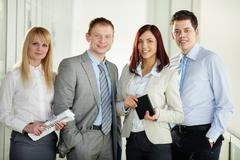 Portrait of four confident business people ready to start the campaign Stock Photos