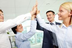 Cheerful business team holding their hands together with enthusiasm Stock Photos