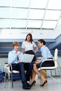 Portrait of confident businesswoman with businessman interviewing woman in the o Stock Photos
