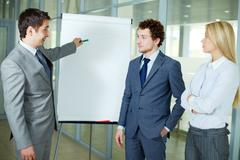Businessman presenting a new project to colleagues Stock Photos
