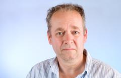 Middle-aged man unhappy about something Stock Photos