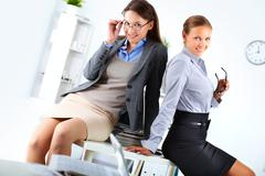 Portrait of elegant businesswomen posing in office Stock Photos