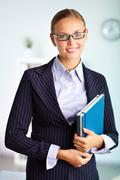 portrait of elegant businesswoman looking at camera - stock photo