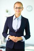 portrait of elegant businesswoman in suit looking at camera - stock photo