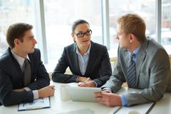 image of group of employees discussing new ideas or project at meeting - stock photo