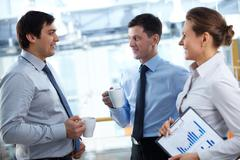 business team having a break and discussing some matters - stock photo