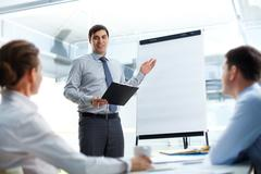 Businessman conducting the presentation of a project Stock Photos
