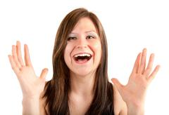 Expression of a woman winning something big Stock Photos