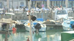 752. boats anchored at Jaffa port with people behind out of focus Stock Footage