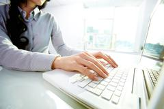 business lady typing on laptop at office - stock photo