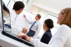 businessman presenting the project to the team of co-workers - stock photo