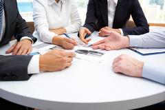 image of business people hands working with papers at meeting - stock photo