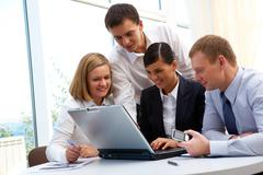 Photo of confident partners planning work at meeting in office Stock Photos