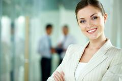 Stock Photo of portrait of a smiling business woman looking confidently at camera