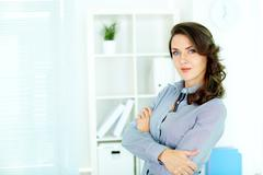 Young business lady with superior look Stock Photos