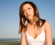 Beautiful brunet portrait under a blue sky Stock Photos