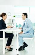 two business partners sitting in office and planning work - stock photo