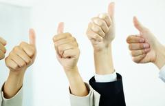 Image of several human hands showing thumbs up in isolation Stock Photos