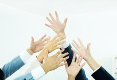 Stock Photo of image of several human hands showing thumbs up in isolation