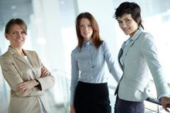 image of three businesswomen looking at camera - stock photo
