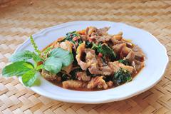 thai food, pork,with chili pepper and sweet basil. - stock photo