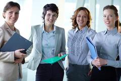 image of four successful businesswomen looking at camera - stock photo