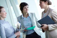 Image of confident businesswomen interacting at meeting Stock Photos