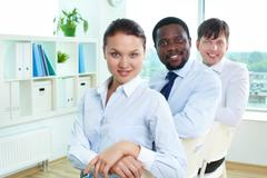 portrait of successful business team with pretty leader in front - stock photo
