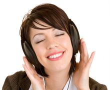 Stock Photo of lady listening to music with headphones