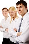 vertical portrait of a strong and dedicated business team - stock photo