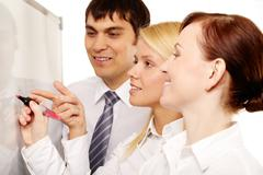 positive office workers discussing new strategy - stock photo